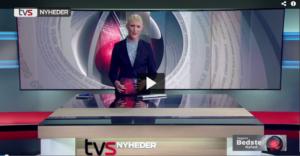 De børstede tænder på TV-journalisten
